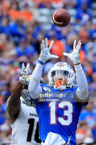 Donovan Stiner of the Florida Gators makes an interception against Kalija Lipscomb of the Vanderbilt Commodores during the game at Ben Hill Griffin...