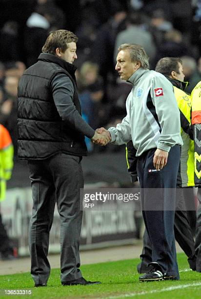 MK Dons' English manager Karl Robinson shakes hands with Queens Park Rangers' English manager Neil Warnock their 11 draw in the English FA Cup 3rd...