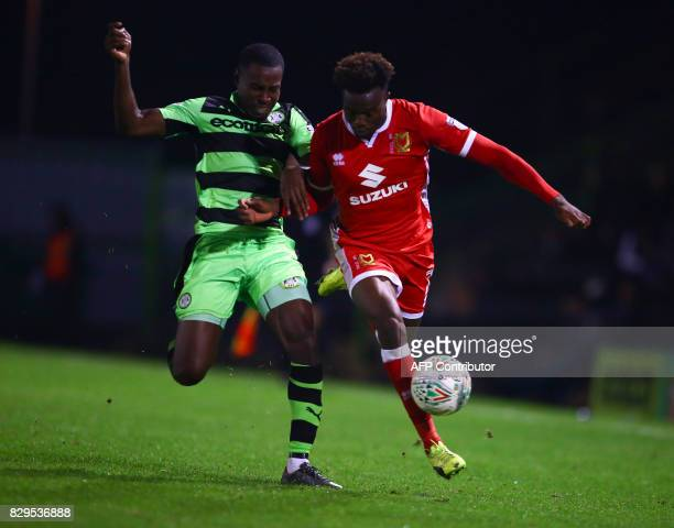 MK Dons' Gboly Ariyibi vies for the ball during the EFL Cup football match between Forest Green Rovers and MK Dons at The New Lawn stadium in...