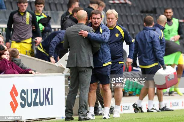 MK Dons manager Paul Tisdale and Burton Albion's manager Nigel Clough during the second half of the Sky Bet League 1 match between MK Dons and Burton...