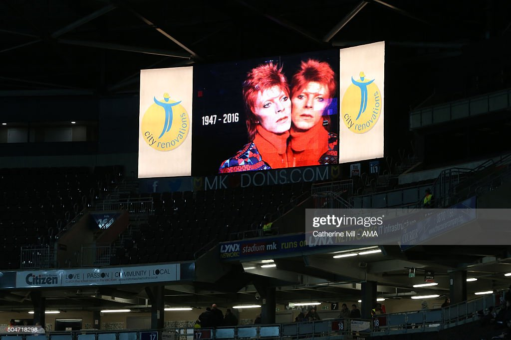 MK Dons pay tribute to David Bowie, who passed away on Monday, by showing his image on the giant screen as his music is played during the warm up before the Sky Bet Championship match between MK Dons and Burnley at Stadium mk on January 12, 2016 in Milton Keynes, England.