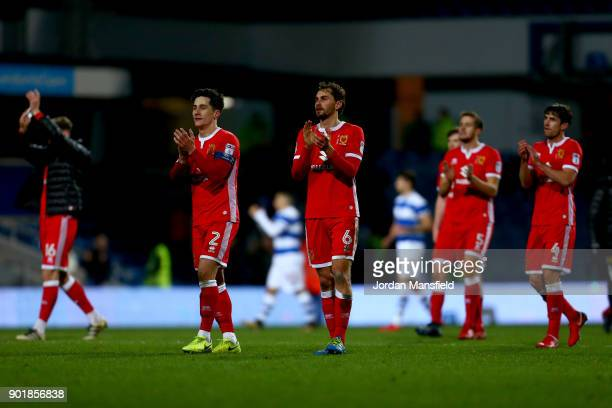 Dons players celebrate at the final whistle after victory during The Emirates FA Cup Third Round match between Queens Park Rangers and Milton Keynes...