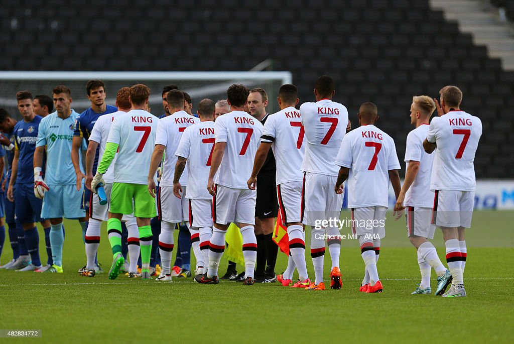MK Dons players wear t-shirts bearing the number 7 in honour of their chief scout and former Everton player Andy King, who died suddenly in May before the pre-season friendly between MK Dons and Getafe at Stadium mk on July 28, 2015 in Milton Keynes, England.