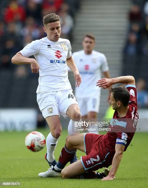 MK Dons Ryan Colclough and Port Vale Ben Purkiss battle for the ball