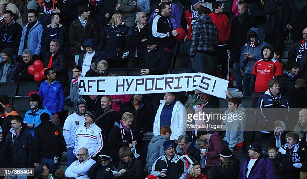 Dons supporters hold up a banner during the FA Cup with Budweiser Second Round match between MK Dons and AFC Wimbledon at StadiumMK on December 2...
