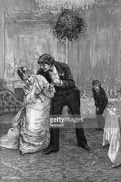 'Don't Cousin Charlie' trying to steal a kiss under the mistletoe during Christmas time Undated engraving by FBarnard circa 1880