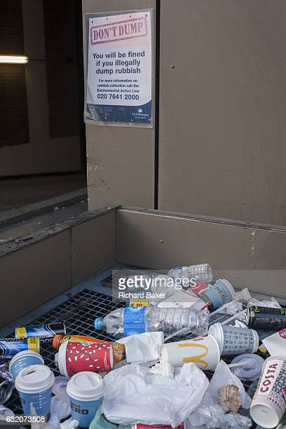 A Don't Dump sign on a wall above discarded street rubbish on 11th January 2017 in London England Nearly half the population admit to dropping litter...