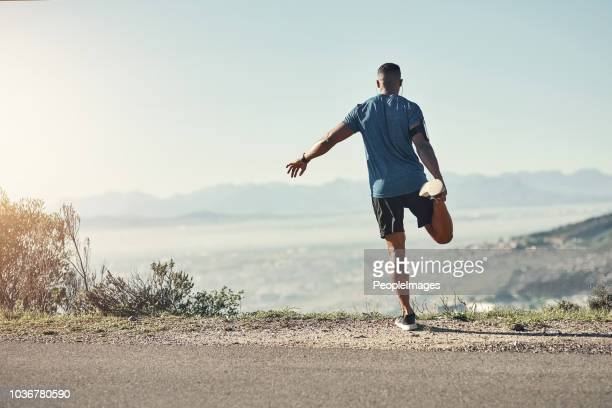 don't ever forget to stretch before a run - stretching stock pictures, royalty-free photos & images