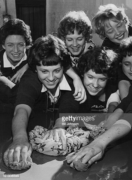 FEB 3 1962 FEB 4 1962 Don't Forget to Wash Behind the Gears These girls sophomores from St Mary's Academy in Englewood earned money for their class...