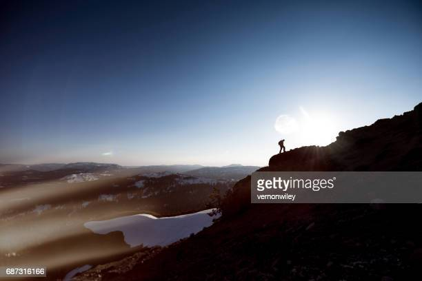 don't give up, mountaineer nearing summit of mountain - steep stock photos and pictures