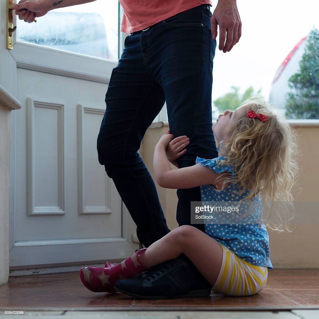 Don't go dad! : Stock Photo