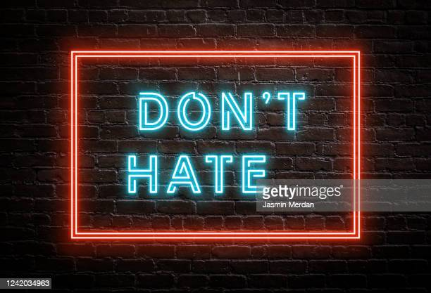 don't hate - neon message on brick wall - blackout tuesday stock pictures, royalty-free photos & images