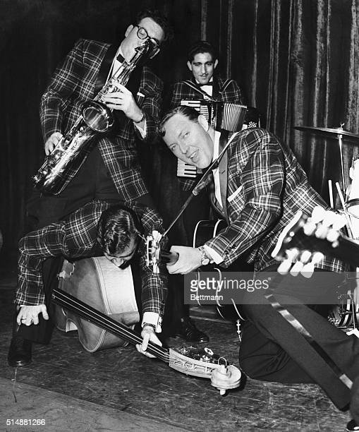 'Don't just playDo something 'That's the advice Bill Haley gives to his 'Comets' Here they are doing just that during a rehearsal at the Dominion...