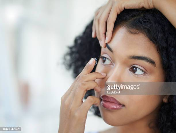 don't let glasses get in your way - contacts stock photos and pictures