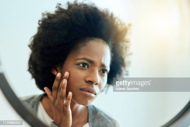 i don't like the look of this... - light skin black woman stock photos and pictures