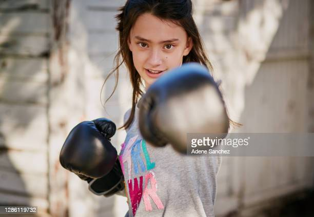 don't mess with this little miss - aggression stock pictures, royalty-free photos & images