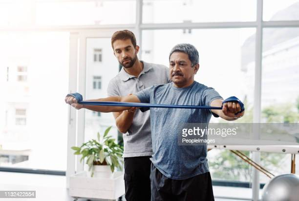 don't over stretch or you'll get hurt - fisioterapia foto e immagini stock