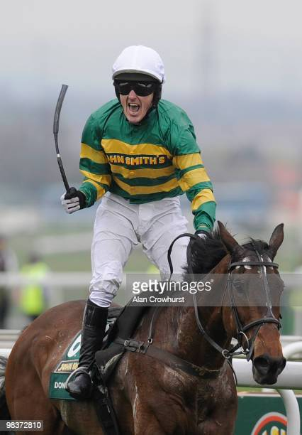 Don't Push It and Tony McCoy win the John Smith's Grand National Steeple Chase at Aintree racecourse on April 10 2010 in Liverpool England
