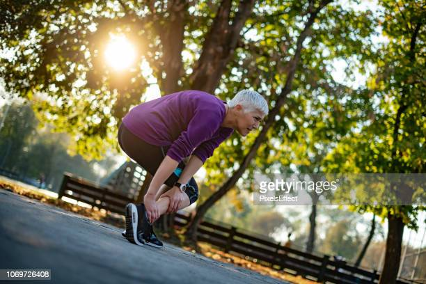 don't put too much pressure on your body - old lady feet stock pictures, royalty-free photos & images