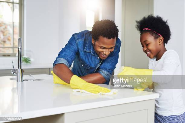 don't tell mom that dad helps me with my chores - kids with cleaning rubber gloves stock pictures, royalty-free photos & images