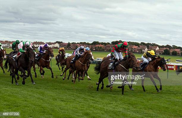 Don't Touch 2nd right Red and Green silks ridden by Tony Hamilton leads the field in the William Hill Ayr Gold Cup on September 19 2015 in Ayr...