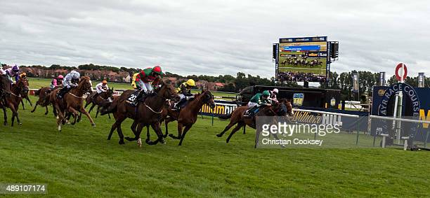 Don't Touch centre Red and Green silks ridden by Tony Hamilton wins the William Hill Ayr Gold Cup on September 19 2015 in Ayr Scotland