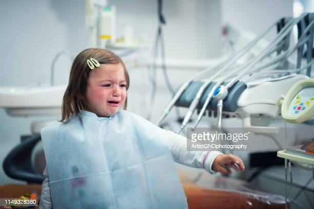 i don't want dentist, child cry - dental fear stock pictures, royalty-free photos & images