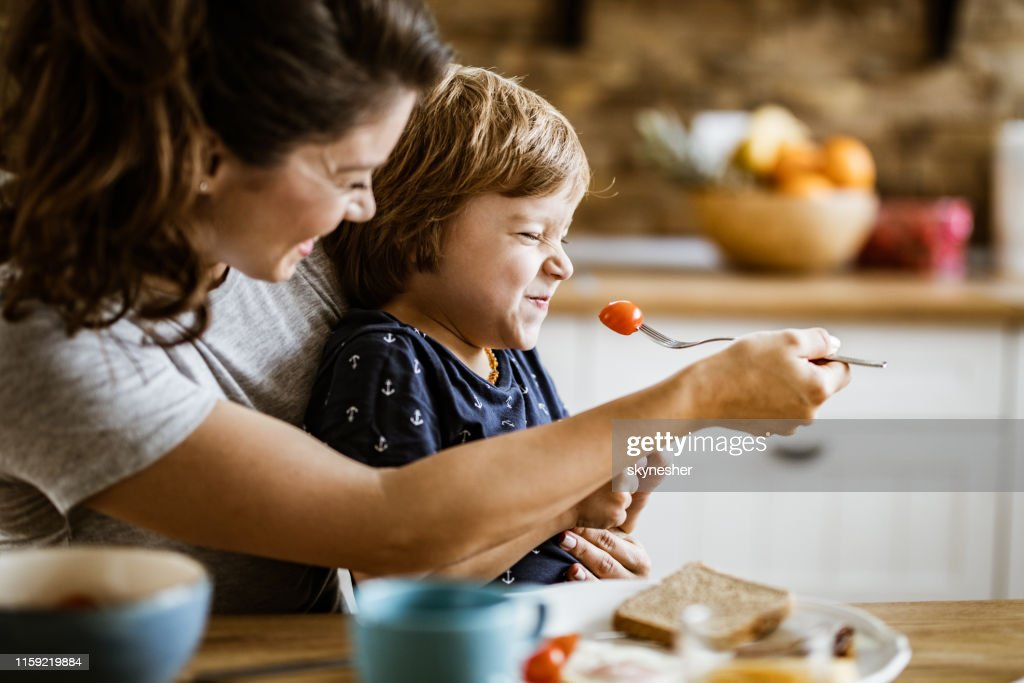 I don't want to eat that mommy! : Stock Photo
