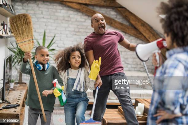 i don't want to see the glimpse of dust in the house! - funny black girl stock photos and pictures