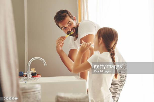 don't you want a smile like this? - domestic bathroom stock pictures, royalty-free photos & images