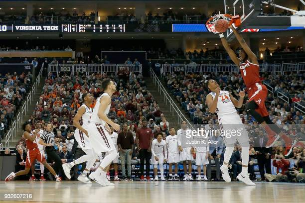 Donta Hall of the Alabama Crimson Tide dunks the ball against the Virginia Tech Hokies during the first half of the game in the first round of the...