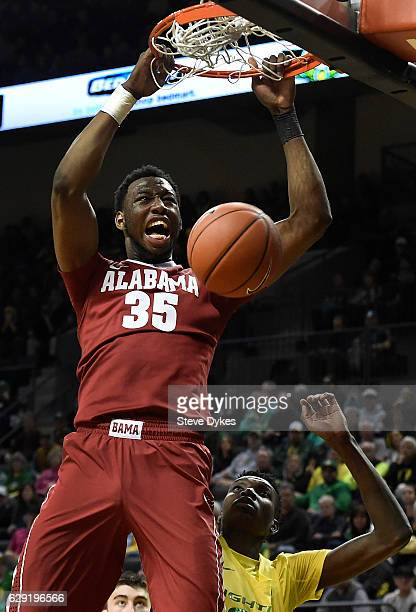 Donta Hall of the Alabama Crimson Tide dunks the ball in the second half of the game against the Oregon Ducks at Matthew Knight Arena on December 11,...