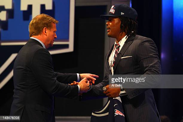 Dont'a Hightower of Alabama greets NFL Commissioner Roger Goodell after he was selected overall by the New England Patriots in the first round of the...