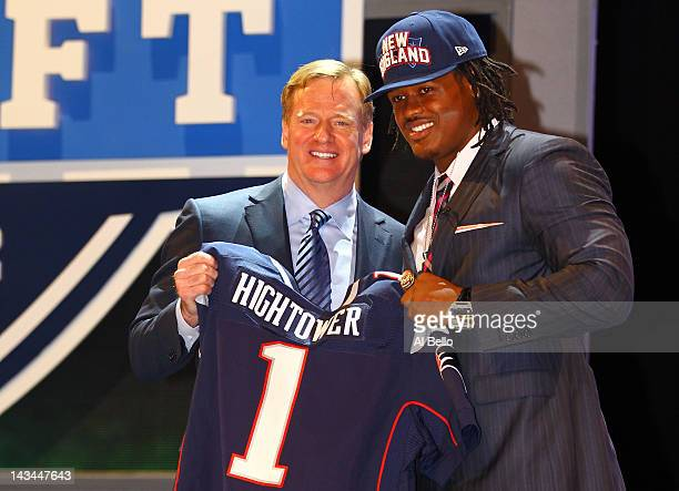 Dont'a Hightower of Alabama holds up a jersey as he stands on stage with NFL Commissioner Roger Goodell after he was selected overall by the New...