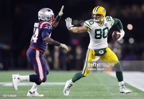 Dont'a Hightower of the New England Patriots attempts to tackle Jimmy Graham of the Green Bay Packers during the first half at Gillette Stadium on...