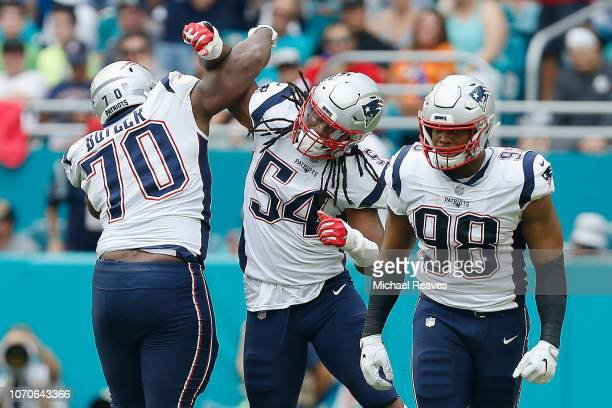 Dont'a Hightower of the New England Patriots celebrating with teammates during the second quarter against the Miami Dolphins at Hard Rock Stadium on...