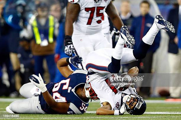 Dont'a Hightower of the New England Patriots tackles DeVier Posey of the Houston Texans during the 2013 AFC Divisional Playoffs game at Gillette...
