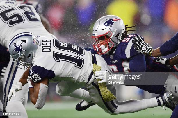 Dont'a Hightower of the New England Patriots tackles Randall Cobb of the Dallas Cowboys during the first half in the game at Gillette Stadium on...