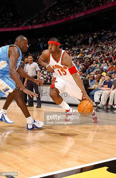 Donta Smith of the Atlanta Hawks drives along the baseline against Francisco Elson of the Denver Nuggets on February 15 2005 at Philips Arena in...
