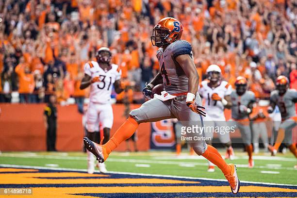 Dontae Strickland of the Syracuse Orange celebrates a fourth quarter touchdown run against the Virginia Tech Hokies on October 15 2016 at The Carrier...
