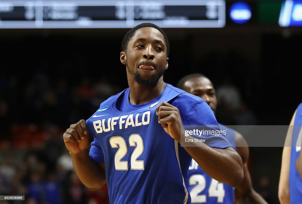 Dontay Caruthers #22 of the Buffalo Bulls celebrates defeating the Arizona Wildcats 89-68 during the first round of the 2018 NCAA Men's Basketball Tournament at Taco Bell Arena on March 15, 2018 in Boise, Idaho.
