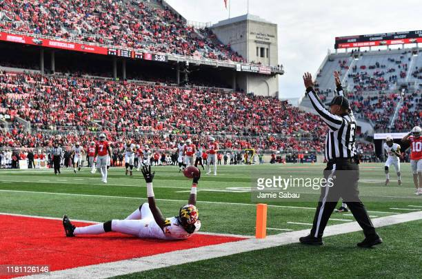 Dontay Demus Jr. #7 of the Maryland Terrapins celebrates in the end zone as the field judge signals a touchdown after Demus Jr. Caught a 26-yard pass...