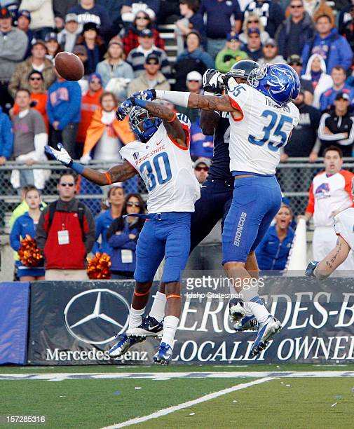 Donte Deayon of the Boise State Broncos and Darian Thompson of the Boise State Broncos break up a hail Mary pass to end the game against University...