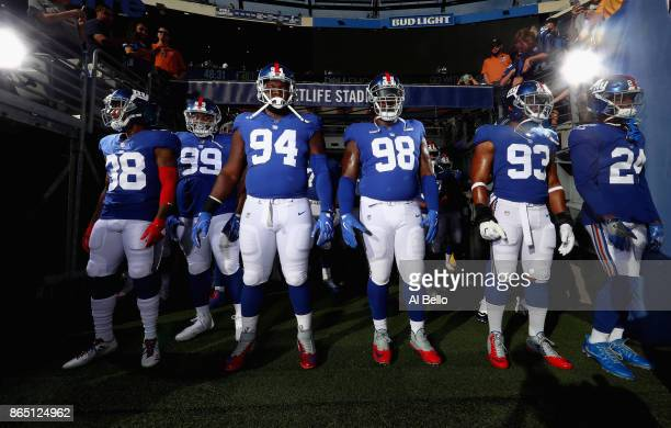 Donte Deayon Robert Thomas Dalvin Tomlinson Damon Harrison BJ Goodson and Eli Apple of the New York Giants stand outside of the tunnel before...