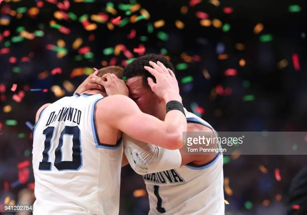 Donte DiVincenzo and Jalen Brunson of the Villanova Wildcats celebrate after defeating the Michigan Wolverines during the 2018 NCAA Men's Final Four...