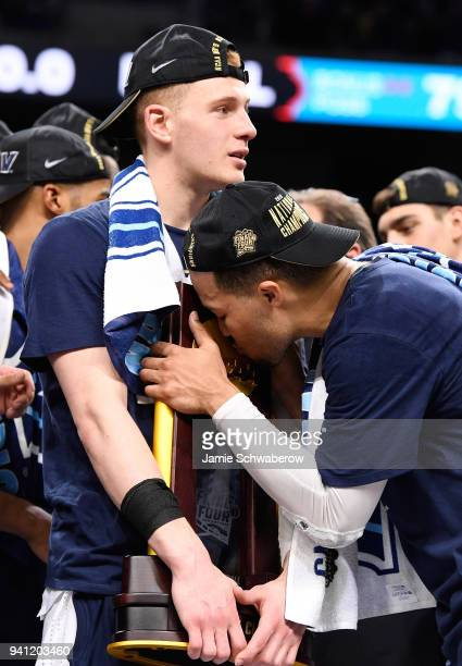 Donte DiVincenzo and Jalen Brunson of the Villanova Wildcats celebrate with the trophy after the 2018 NCAA Photos via Getty Images Men's Final Four...