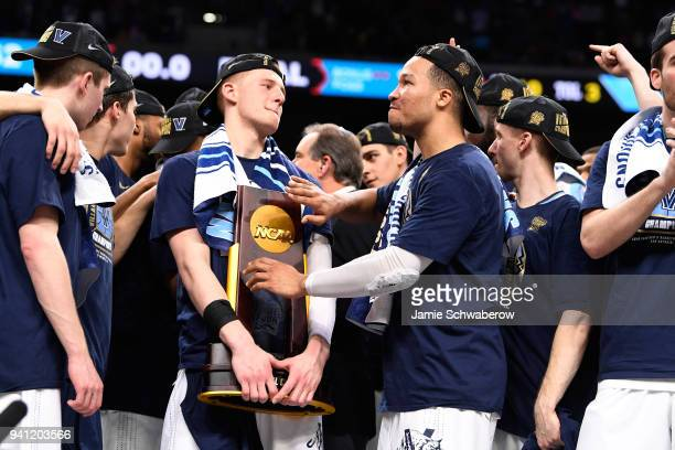 Donte DiVincenzo and Jalen Brunson of the Villanova Wildcats celebrate wiuth the trophy after the 2018 NCAA Photos via Getty Images Men's Final Four...