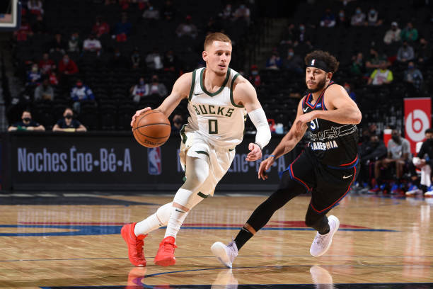 Donte DiVincenzo of the Milwaukee Bucks drives to the basket against the Philadelphia 76ers on March 17, 2021 at Wells Fargo Center in Philadelphia,...