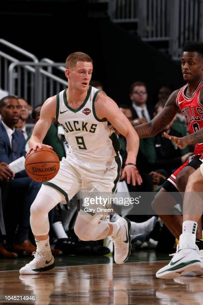 Donte DiVincenzo of the Milwaukee Bucks handles the ball against the Chicago Bulls during a preseason game on October 3 2018 at Fiserv Forum in...
