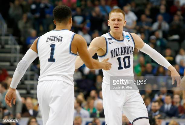 Donte DiVincenzo of the Villanova Wildcats celebrates with his teammate Jalen Brunson against the Alabama Crimson Tide during the second half in the...